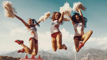 Cheerleaders perform during a break in play