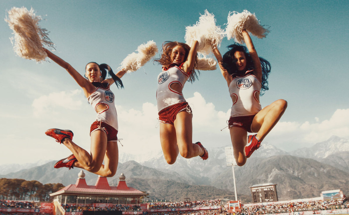 Cheerleaders perform during a break in play