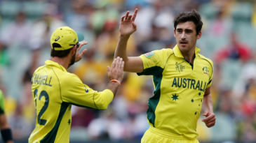 Mitchell Starc celebrates his 17th wicket of the tournament
