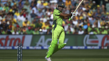 Sohaib Maqsood is airborne to cut the ball