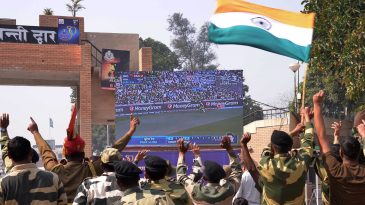 Indian Border Security Force personnel watch the India-Pakistan World Cup match