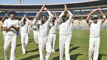 The Karnataka players acknowledge the crowd after successfully defending the Irani Cup