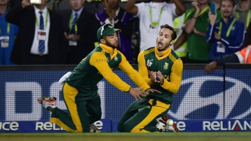 The fatal collision: Farhaan Behardien and JP Duminy spill Grant Elliott after bumping into each other