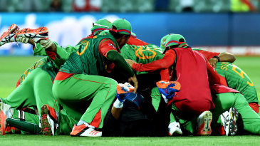The Bangladesh players pile on top of each other after their victory