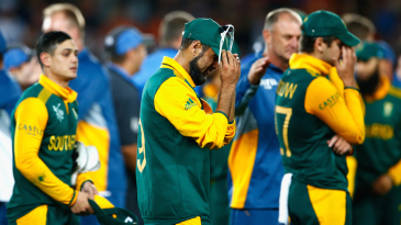 The South African team walks back in low spirits