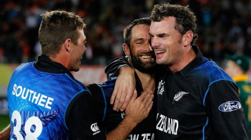 Grant Elliott, Kyle Mills and Tim Southee soak in the historic win