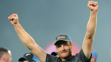 Martin Guptill has his hands aloft in joy