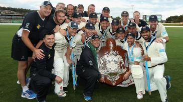 Victoria celebrate after winning the Sheffield Shield for 2014-15