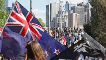 New Zealand fans make their way to the MCG, ahead of the World Cup final