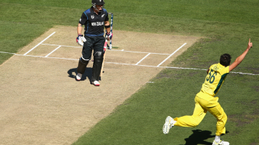 Mitchell Starc races away after bowling Brendon McCullum
