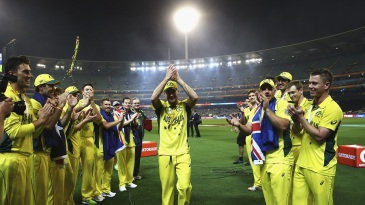 Australia's players give Michael Clarke a guard of honour