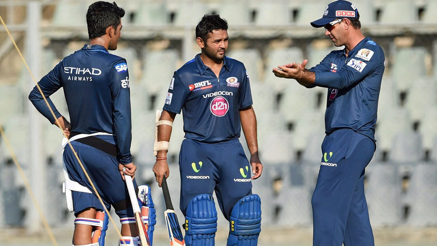 Ricky Ponting shares a few tips with Parthiv Patel during a training session