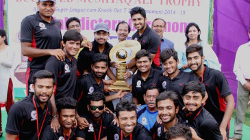 The Gujarat team poses with the Syed Mushtaq Ali trophy