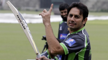 Saeed Ajmal gestures on the sidelines of a practice session