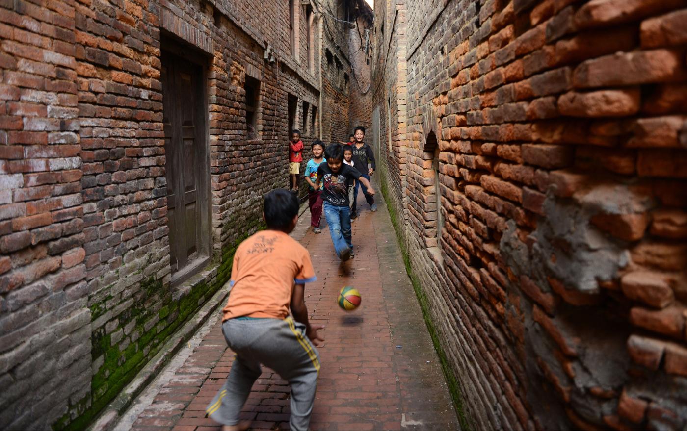 Football? Futsal? If it involves kicking a ball around, they'll play it in Nepal