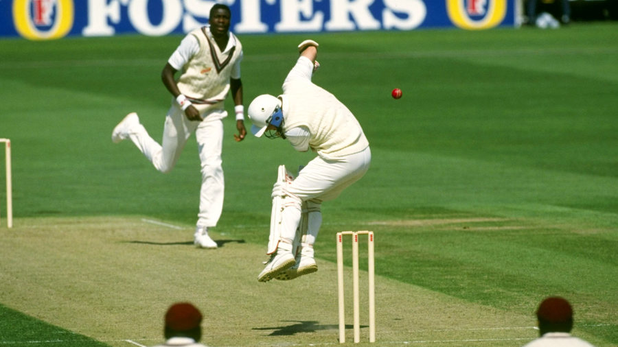 Hugh Morris tries to avoid a bouncer from Curtly Ambrose