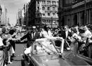 West Indies team manager Gerry Gomez and captain Frank Worrell are cheered by a huge crowd in a parade through the streets of Melbourne, February 20, 1961