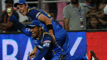 Tim Southee and Karun Nair celebrate their stunning relay catch near the boundary