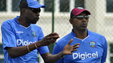 Curtly Ambrose and Phil Simmons watch over a training session