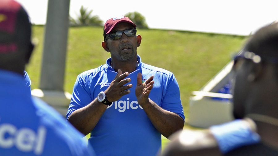 Phil Simmons talks to the West Indies side during a training session
