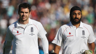 James Anderson and Monty Panesar walk back after securing the draw