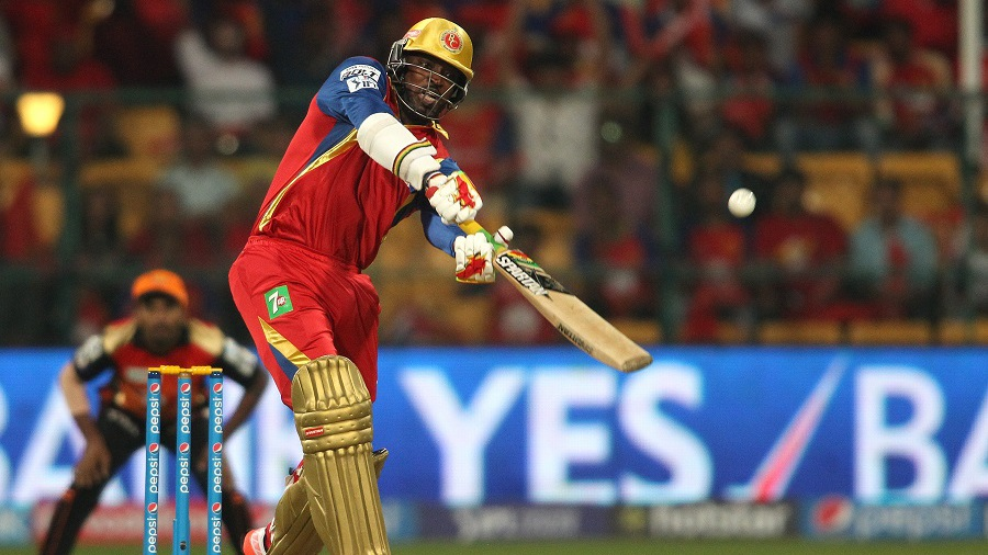 Up, up and away: Chris Gayle takes the aerial route