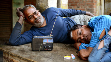 Mechanics in Ahmedabad listen to the India-Pakistan World Cup match on the radio
