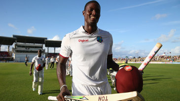 Jason Holder leaves the field beaming after his maiden Test century saved the match