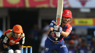 JP Duminy drives down the ground during his 41-ball 54
