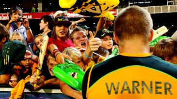 David Warner signs autographs for kids