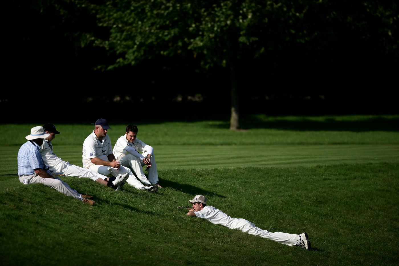 Players sit by the boundary