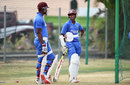 Marlon Samuels and Shivnarine Chanderpaul wait to bat, Grenada, April 20, 2015