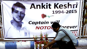 A poster in memory of Ankit Keshri, the Bengal player who died in hospital