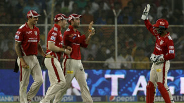 Glenn Maxwell celebrates a wicket with his team-mates