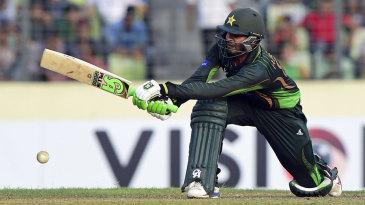 Haris Sohail plays a sweep shot during his 52