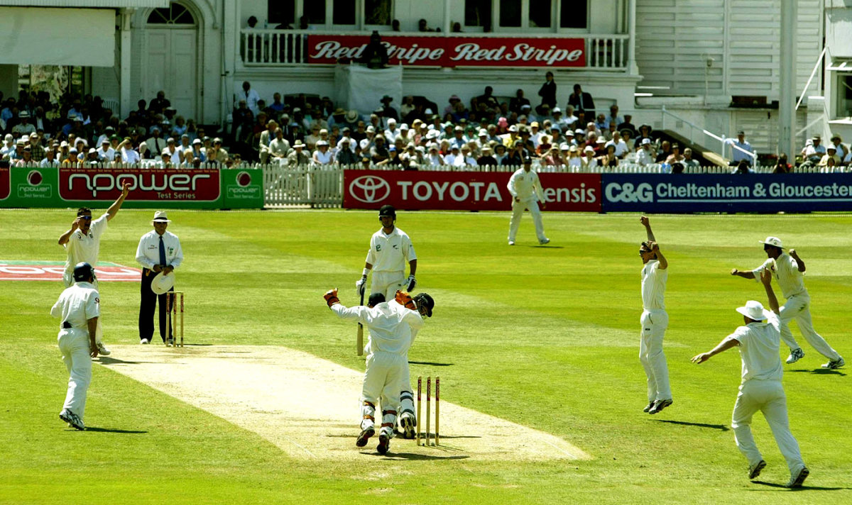 Ashley Giles celebrates the wicket of Chris Cairns