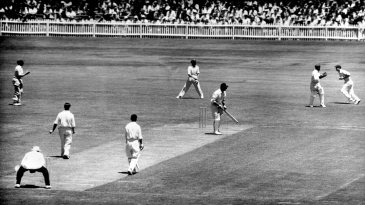 Bob Simpson takes a catch to dismiss Vic Wilson off the bowling of Keith Miller