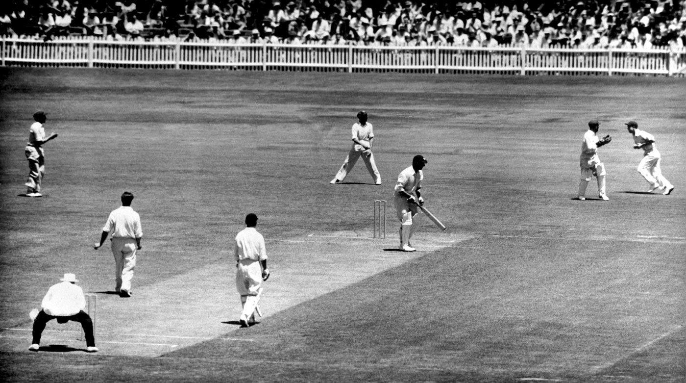 An 18-year-old Simpson, playing for NSW, catches England tourist Vic Wilson off Keith Miller's bowling