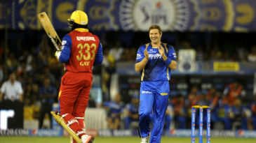 Shane Watson celebrates the wicket of Chris Gayle