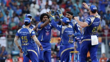 Lasith Malinga is mobbed by his team-mates
