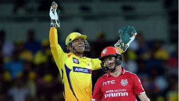 MS Dhoni exults after taking a catch to dismiss George Bailey