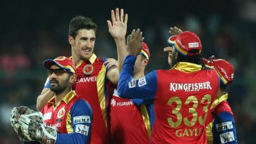 Mitchell Starc is mobbed by his team-mates