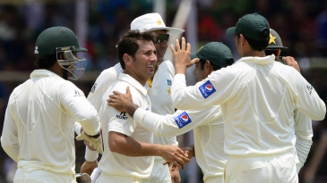 Yasir Shah is congratulated after he dismissed Tamim Iqbal