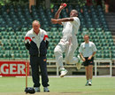 Devon Malcolm bowls as Ray Illingworth looks on, Johannesburg, November 29, 1995
