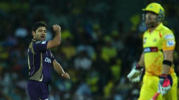 Piyush Chawla celebrates the wicket of Brendon McCullum