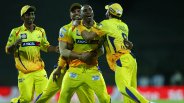 Dwayne Bravo is mobbed by his team-mates after taking a diving catch