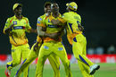 Dwayne Bravo is mobbed by his team-mates after taking a diving catch, Chennai Super Kings v Kolkata Knight Riders, IPL 2015, Chennai, April 28, 2015