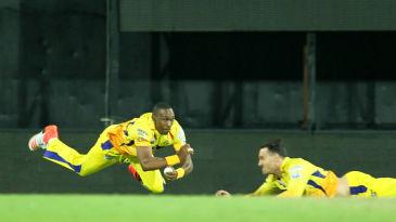 Dwayne Bravo takes a diving catch