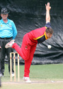 Simon Cook delivers. Umpire is Clive Howard, HKCC v. Ch. Auto Pakistan Association at Hong Kong Cricket Club. 26th April 2015