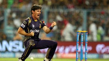 Brad Hogg celebrates a wicket